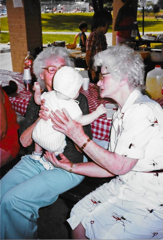 Aunt Jennie (left) and Grandma (Elsie) passsing my son back and forth at the reunion in June of 1986.
