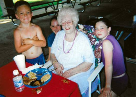 Elsie with great-grandchildren Jerrid, Deanna, and Shaunna at the Hackathorn Reunion.